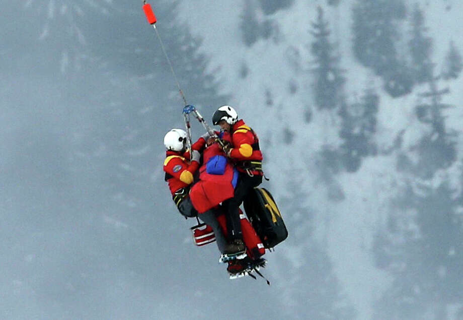 United States' Lindsey Vonn is airlifted after crashing during the women's super-G course, at the Alpine skiing world championships in Schladming, Austria, Tuesday, Feb.5, 2013. Lindsey Vonn has been helicoptered to hospital from the Alpine skiing world championships after crashing and apparently hurting her right knee in the super-G race. (AP Photo/Luca Bruno) Photo: Luca Bruno