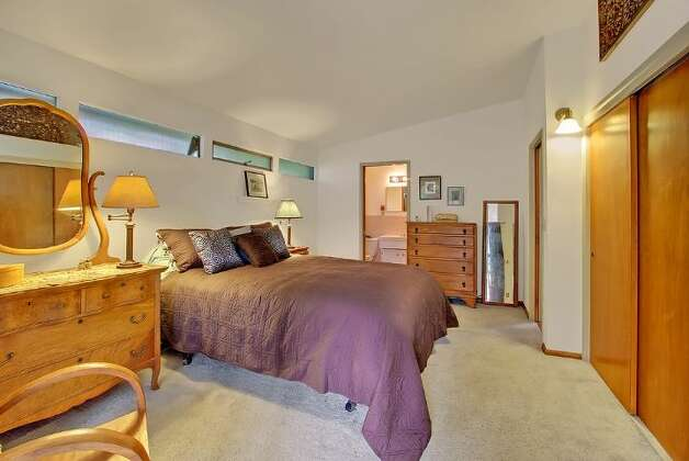 Bedroom of 5417 S. Orcas St. The 2,820-square-foot home, built in 1955, has three bedrooms, 2.5 bathrooms, vaulted, cedar-lined ceilings, a family room with a fireplace, a wine cellar, a deck, a view of Lake Washington and a two-car garage on a 9,000-square-foot lot. It's listed for $521,550. Photo: Courtesy Al Johnson/ Windermere Real Estate