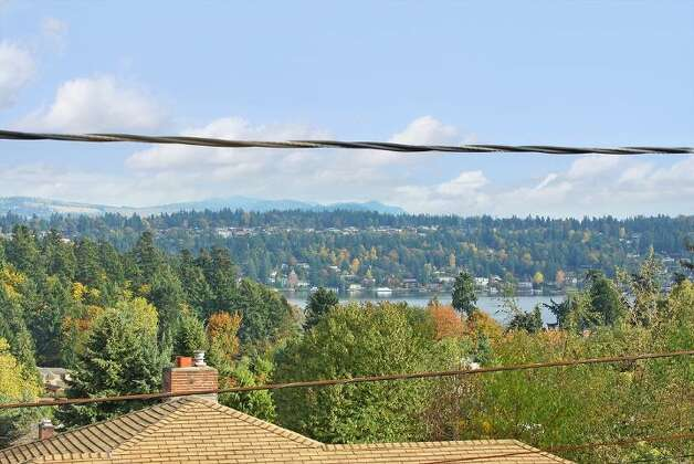 View from 5417 S. Orcas St. The 2,820-square-foot home, built in 1955, has three bedrooms, 2.5 bathrooms, vaulted, cedar-lined ceilings, a family room with a fireplace, a wine cellar, a deck and a two-car garage on a 9,000-square-foot lot. It's listed for $521,550. Photo: Courtesy Al Johnson/ Windermere Real Estate