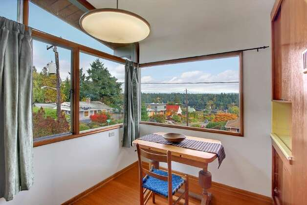 Breakfast nook of 5417 S. Orcas St. The 2,820-square-foot home, built in 1955, has three bedrooms, 2.5 bathrooms, vaulted, cedar-lined ceilings, a family room with a fireplace, a wine cellar, a deck, a view of Lake Washington and a two-car garage on a 9,000-square-foot lot. It's listed for $521,550. Photo: Courtesy Al Johnson/ Windermere Real Estate