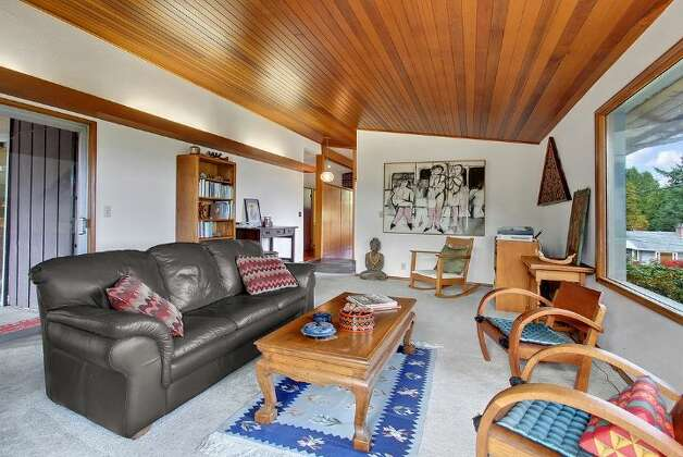 Living room of 5417 S. Orcas St. The 2,820-square-foot home, built in 1955, has three bedrooms, 2.5 bathrooms, vaulted, cedar-lined ceilings, a family room with a fireplace, a wine cellar, a deck, a view of Lake Washington and a two-car garage on a 9,000-square-foot lot. It's listed for $521,550. Photo: Courtesy Al Johnson/ Windermere Real Estate