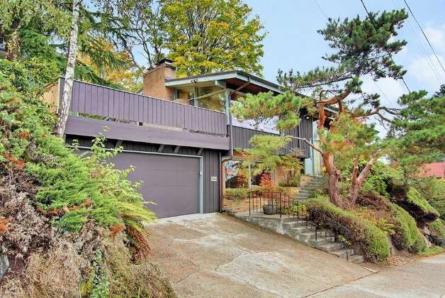 Next comes 5417 S. Orcas St. The 2,820-square-foot home, built in 1955, has three bedrooms, 2.5 bathrooms, vaulted, cedar-lined ceilings, a family room with a fireplace, a wine cellar, a deck, a view of Lake Washington and a two-car garage on a 9,000-square-foot lot. It's listed for $521,550. Photo: Courtesy Al Johnson/ Windermere Real Estate