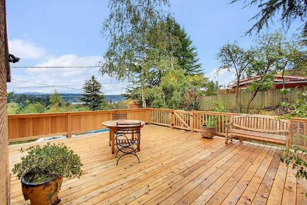 Deck of 5417 S. Orcas St. The 2,820-square-foot home, built in 1955, has three bedrooms, 2.5 bathrooms, vaulted, cedar-lined ceilings, a family room with a fireplace, a wine cellar, a view of Lake Washington and a two-car garage on a 9,000-square-foot lot. It's listed for $521,550. Photo: Courtesy Al Johnson/ Windermere Real Estate