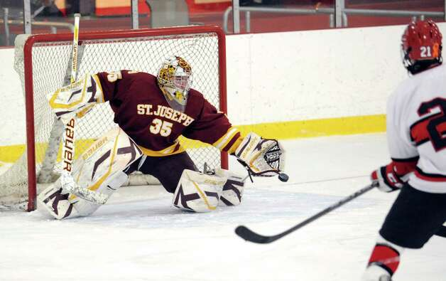 St. Joseph goalie Marc Van Etten # 35 makes a stop on a shot by Ian Fulton # 21 of Greenwich during the boys high school ice hockey game between St. Joseph High School and Greenwich High School at Hamill Rink in Byram, Tuesday night, Feb. 5, 2013. St. Joseph defeated Greenwich, 5-2. Photo: Bob Luckey / Greenwich Time