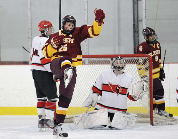 Andrew Gore # 25 of St. Joseph celebrates his second period goal as goalie Bryan Archino of Greenwich looks on during the second period of the high school ice hockey game between St. Joseph High School and Greenwich High School at Hamill Rink in Byram, Tuesday night, Feb. 5, 2013. St. Joseph defeated Greenwich, 5-2. Photo: Bob Luckey / Greenwich Time