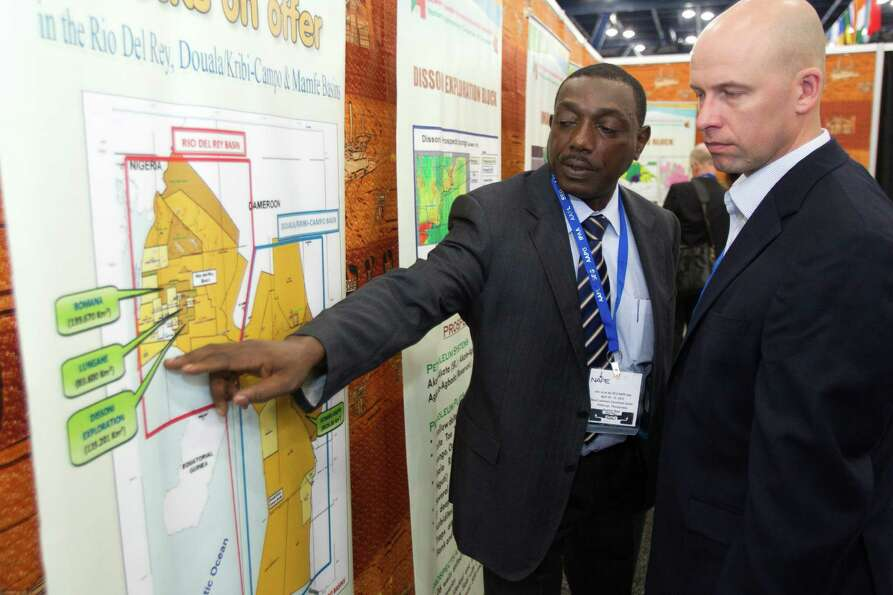 Jifon Francis, left, of the National Hydrocarbons Corporation of Camerooon, shows leasing blocks in