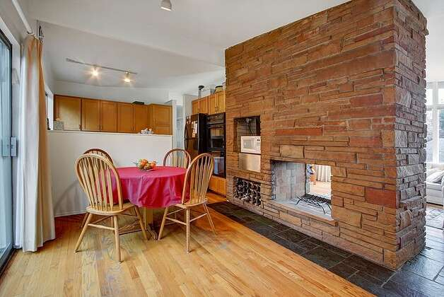Real estate profile feb 5 2013 - Fireplace between two rooms ...