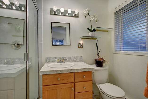 Bathroom of 6749 55th Ave. S. The 2,120-square-foot house, built in 1959, has four bedrooms, 2.75 bathrooms, vaulted ceilings, a two-way fireplace between the living room and dining room, a recreation room with a fireplace, a patio and a two-car garage on a 4,790-square-foot lot. It's listed for $515,000. Photo: Courtesy Liz Azose/Windermere Real Estate