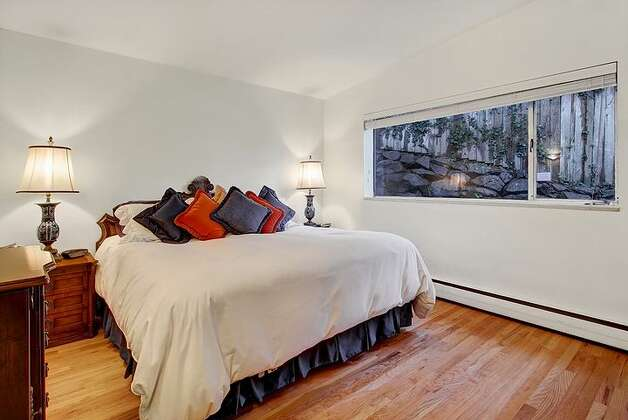 Bedroom of 6749 55th Ave. S. The 2,120-square-foot house, built in 1959, has four bedrooms, 2.75 bathrooms, vaulted ceilings, a two-way fireplace between the living room and dining room, a recreation room with a fireplace, a patio and a two-car garage on a 4,790-square-foot lot. It's listed for $515,000. Photo: Courtesy Liz Azose/Windermere Real Estate