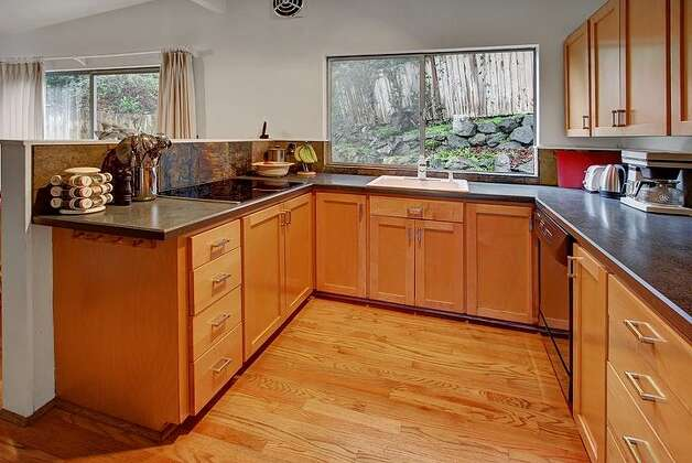 Kitchen of 6749 55th Ave. S. The 2,120-square-foot house, built in 1959, has four bedrooms, 2.75 bathrooms, vaulted ceilings, a two-way fireplace between the living room and dining room, a recreation room with a fireplace, a patio and a two-car garage on a 4,790-square-foot lot. It's listed for $515,000. Photo: Courtesy Liz Azose/Windermere Real Estate