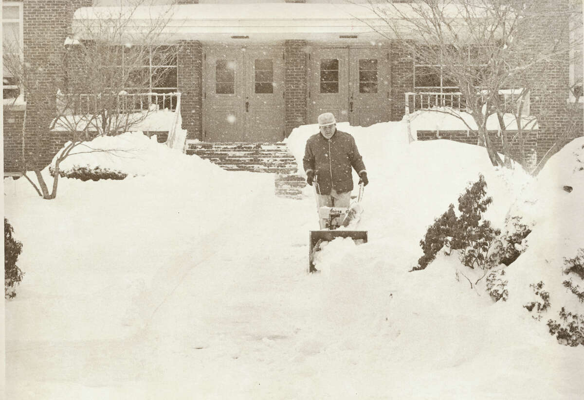 Feb. 7, 1978: Man clears Dolan School's front walk in Stamford, Conn. during the blizzard of 1978. Here's a look at the Northeast's Top 11 storms in the last 60 years, according to the Northeast Snowfall Impact Scale: (Updated from a 2015 report by the Associated Press via the the Northeast Snowfall Impact Scale and the National Weather Service.) 1. FEB. 10-12, 1983 More than a foot of snow dropped from Washington to New England, and more than 20 inches in New York, leading to hundreds of canceled flights and a ruined Valentine's Day for many florists and other love-reliant businesses. Cities and states blew through most of their snow removal budgets for the entire year. ___ 10. DEC. 25-28, 1969 A white Christmas was already on tap for most of New York and much of Vermont after a foot of snow fell on Dec. 22, but another 2 feet would drop during this three-day storm. Some streets in Albany weren't cleared for weeks. One town near Montpelier, Vermont, got 44 inches of snow. ___ 9. JAN. 19-21, 1978 This blizzard was the third of a series of rapid-fire storms to hit the Northeast, bringing with it a fresh foot-plus of snow from Maryland to Maine. Thousands of National Guard troops were called in around the region to help with snow removal. On the banks of Lake Ontario, the city of Oswego was buried under 56 inches of snow over five days.