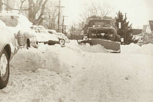 Feb. 7 1978: A snowplow is out on Atlantic St. in Stamford, Conn. while cars sit idle behind heaps of dirty snow after the blizzard of 1978.