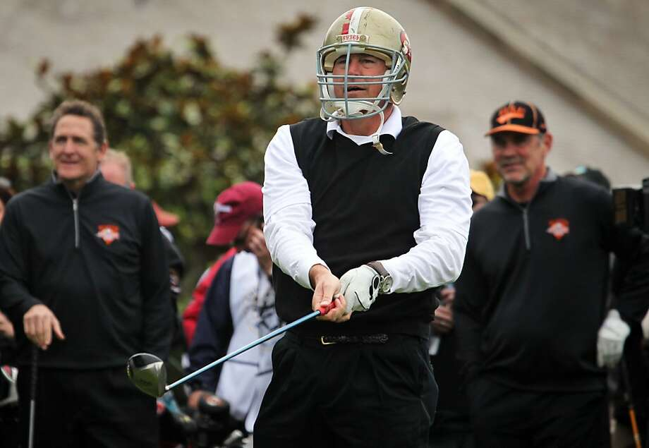 San Francisco 49er Dwight Clark tees off on the 1st hole during the Chevron charity shootout between the 49ers and the San Francisco Giants at the AT&T Pebble Beach National Pro-Am golf tournament in Pebble Beach, California wearing a 49er helmet Tuesday, Feb. 5, 2013. Photo: Lance Iversen, The Chronicle