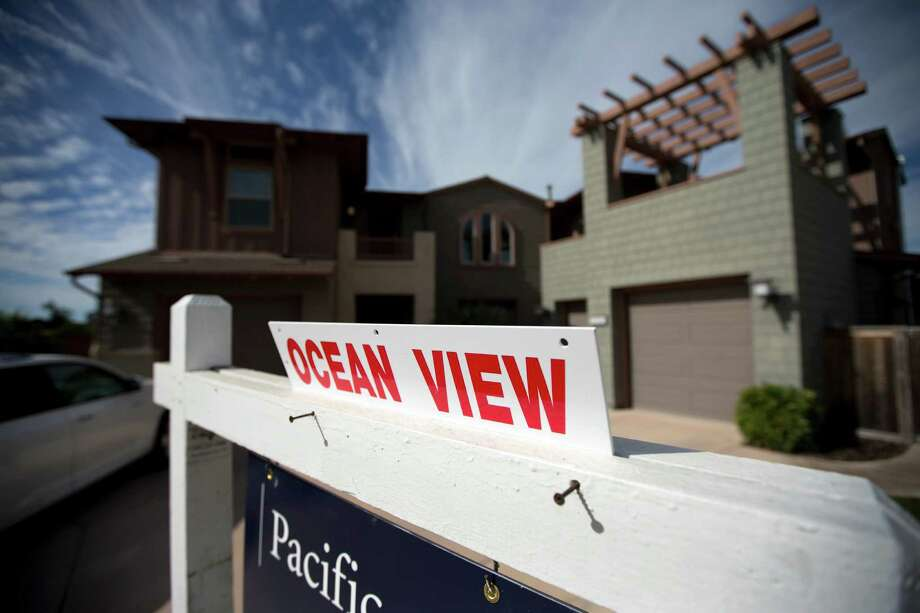 This Wednesday, Nov. 14, 2012, photo, shows a home for sale in Leucadia, Calif. Photo: Gregory Bull, Associated Press / Associated Press