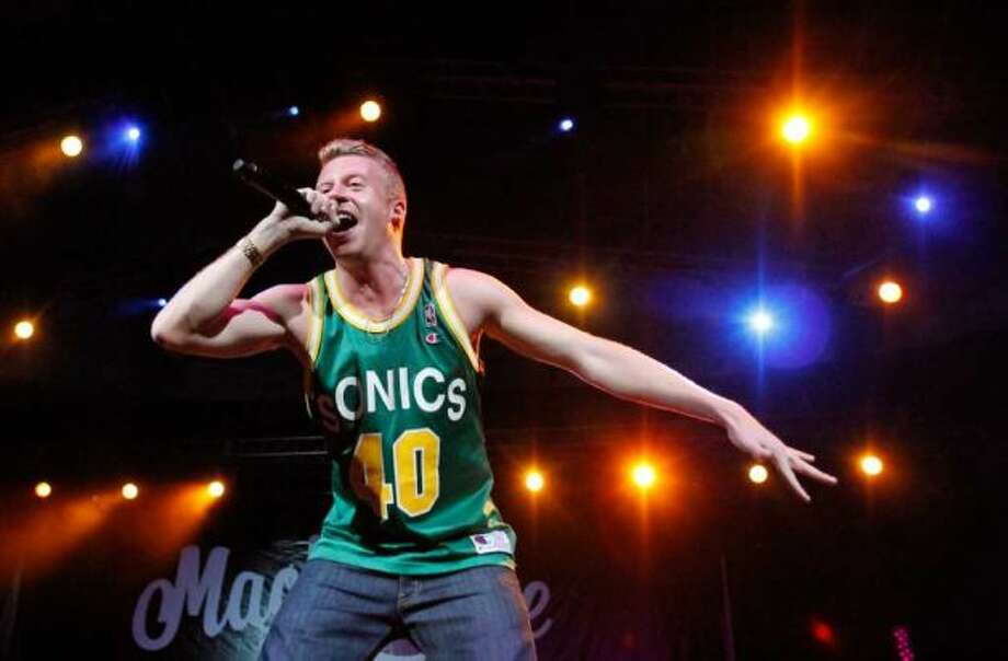 """Macklemore, Garfield and Nathan Hale:Known better then as Ben Haggerty, the rapper has strengthened his  fan base with fan appreciation parties and a 2010 tribute song to Mariners broadcaster Dave Niehaus, which he performed at Opening Day 2011. His record """"The Heist"""" with Ryan Lewis also debuted at No. 1 on the iTunes charts and the pair's first single from the record, """"""""Thrift Shop"""" went platinum and became the first song by a Seattle-area artist to hit No. 1 on the Billboard Hot 100 chart since 1992. (Joe Dyer/seattlepi.com file)"""