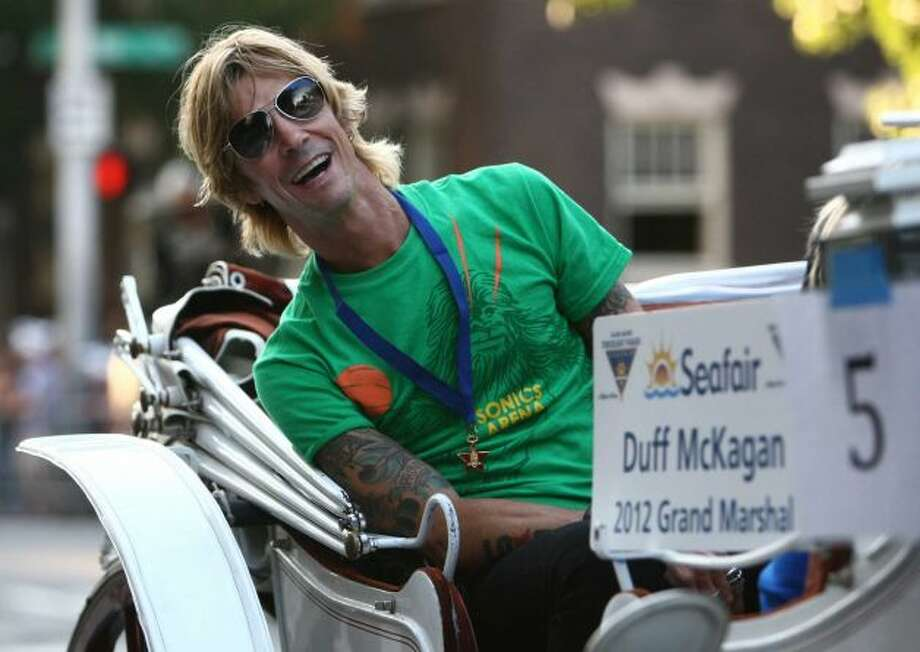 Duff McKagan, Roosevelt:Before gaining international success with Guns N' Roses, McKagan attended Roosevelt High School at the same time as Pearl Jam's Mike McCready. This picture is from July 28 when McKagan was the Seafair Parade Grand Marshal. (Joshua Trujillo/seattlepi.com)