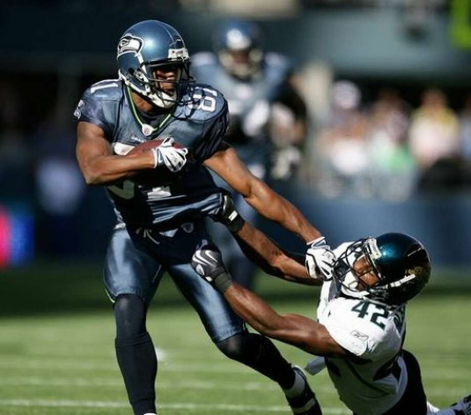 Nate Burleson, O'Dea, 1999:Shown here with the Seahawks in 2009, Burleson is part of Seattle's first family of sports. His brother, Kevin, played in the NBA. His father, Al, was an All-Pac-8 safety at the University of Washington and was the hero of the 1975 Apple Cup. He later played six seasons in the CFL. (Getty Images)