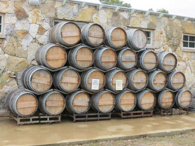 The Wimberley Valley Winery's tasting room will have been open for two years in April. The barrels outside the winery can be purchased in whole, half or one-quarter. Photo: San Antonio Express-News