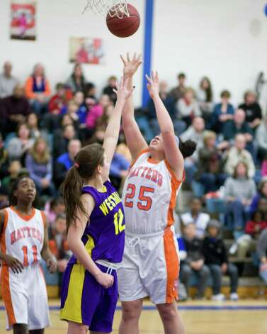 Danbury's Kayla Hnadberry scores from inside against Westhill Tuesday night at Danbury High School. Photo: Barry Horn