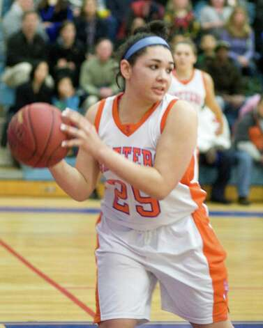 Danbury center Kayla Handberry saves the ball from going out of bounds against Westhill Tuesday night at Danbury High School. Photo: Barry Horn
