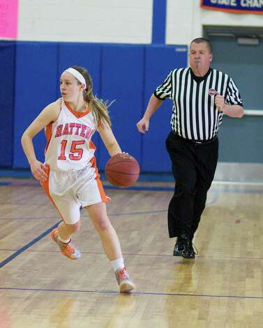 Danbury's Rebecca Gartner looks for an open teammate while bringing the ball up court against Westhill Tuesday night at Danbury High School. Photo: Barry Horn