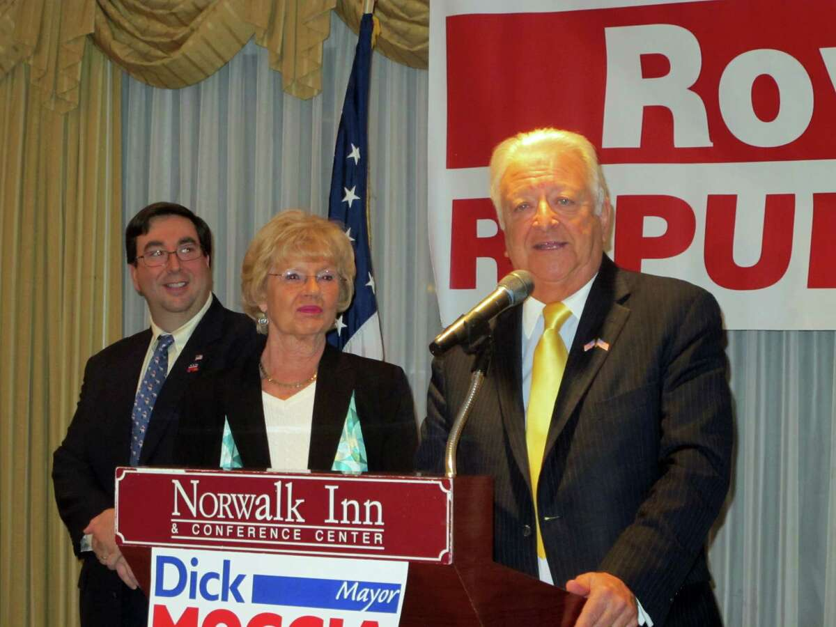 Norwalk Mayor RIchard Moccia tells supporters at the Norwalk Inn on Tuesday that he will seek reelection as his wife Barbara and Republican Town Committee Chair Art Scialabba looks on.