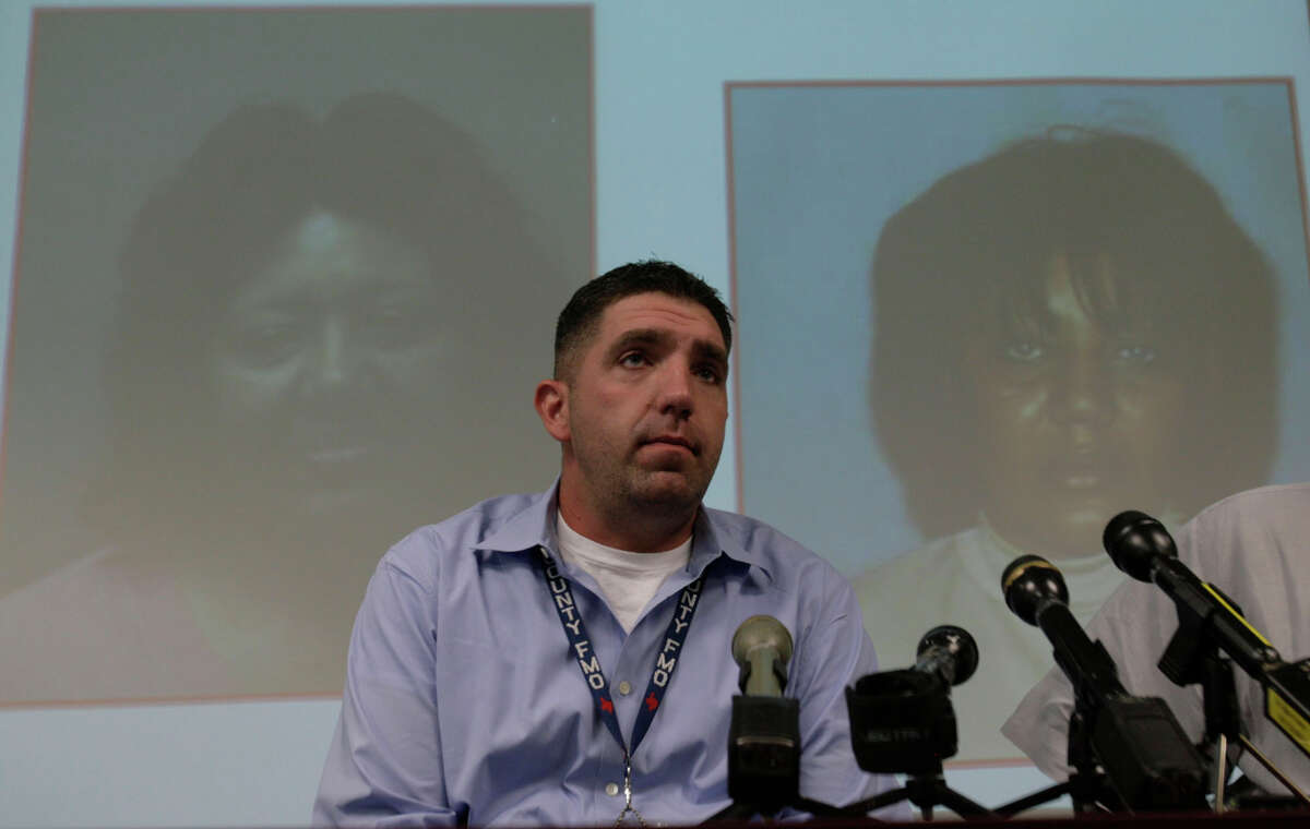 Lonnie Blevins, senior investigator for the Harris County Fire Marshal's Office, releases information about Sharon Watkins, seen in a mug shot, left, and a driver license photo, as the Fire Marshal's Office talked on Wednesday, Sept. 3, 2008, in Houston, about the Harris County grand jury indictment of Watkins and her husband, David Watkins, for a 2003 house fire in northwest Harris County that killed Shanda Watkins, 8, and Raymond Farley, 16. ( Julio Cortez / Chronicle )