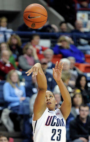 Connecticut's Kaleena Mosqueda-Lewis shoots during the second half of her team's 94-37 victory over Marquette in an NCAA college basketball game in Storrs, Conn., Tuesday, Feb. 5, 2013. Mosqueda-Lewis scored a game-high 22 points in the victory. (AP Photo/Fred Beckham) Photo: Fred Beckham, Associated Press / FR153656 AP