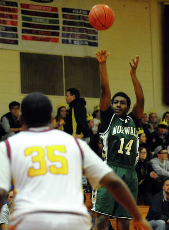 Norwalk's #14 Jabari Dear looks to score, during boys basketball action against St. Joseph in Trumbull, Conn. on Tuesday February 2, 2013. Photo: Christian Abraham / Connecticut Post