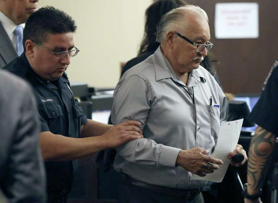 Urbano Bedo Bermea, 72 (right), is escorted out of court after pleading no contest to aggravated sexual assault. Photo: William Luther / San Antonio Express-News