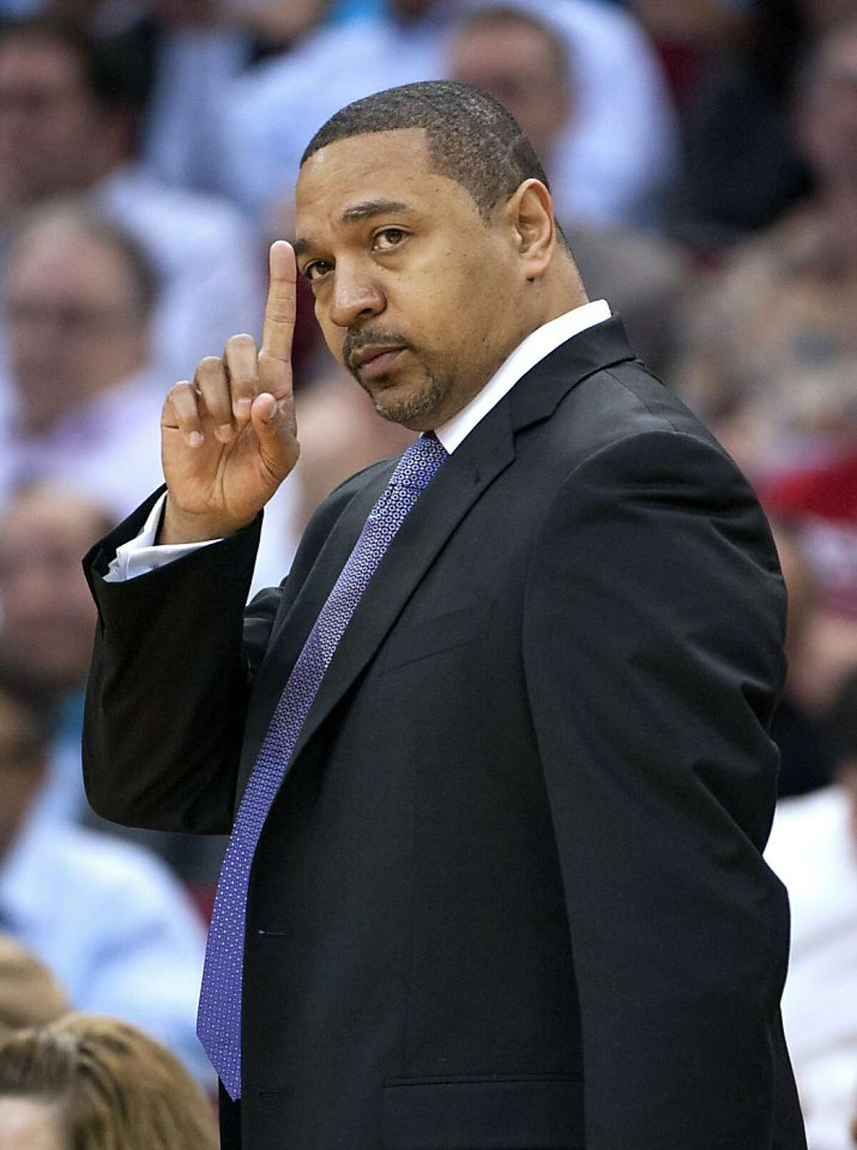 Golden State Warriors head coach Mark Jackson signals a play during the first quarter of an NBA basketball game against the Houston Rockets, Tuesday, Feb. 5, 2013, in Houston. (AP Photo/Dave Einsel)