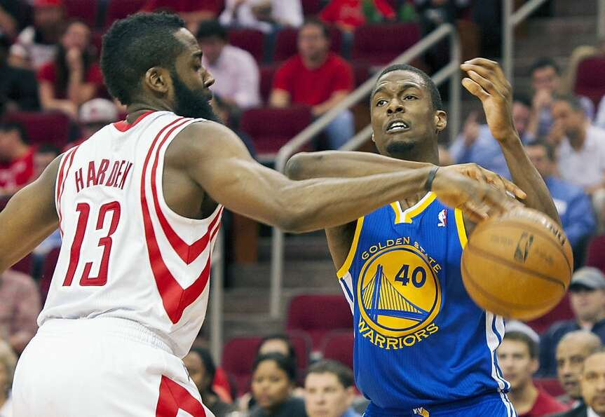 Houston Rockets' James Harden (13) knocks the ball away from Golden State Warriors' Harrison Barnes