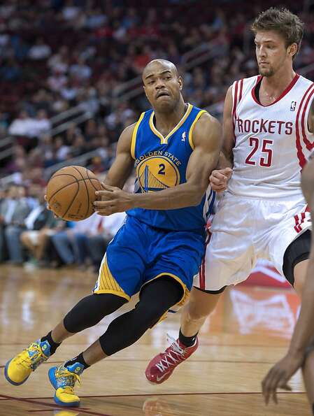 Golden State Warriors' Jarrett Jack (2) drives around Houston Rockets' Chandler Parsons (25) during