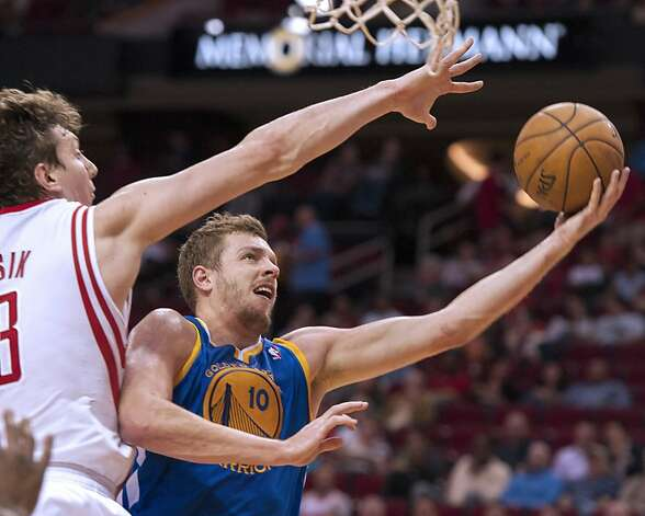 Golden State Warriors' David Lee (10) drives by Houston Rockets' Omer Asik, left, during the first quarter of an NBA basketball game, Tuesday, Feb. 5, 2013, in Houston. (AP Photo/Dave Einsel) Photo: Dave Einsel, Associated Press