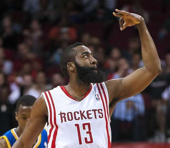 Houston Rockets' James Harden signals to the crowd after shooting a 3-point basket during the first quarter of an NBA basketball game against the Golden State Warriors, Tuesday, Feb. 5, 2013, in Houston. (AP Photo/Dave Einsel) Photo: Dave Einsel, Associated Press