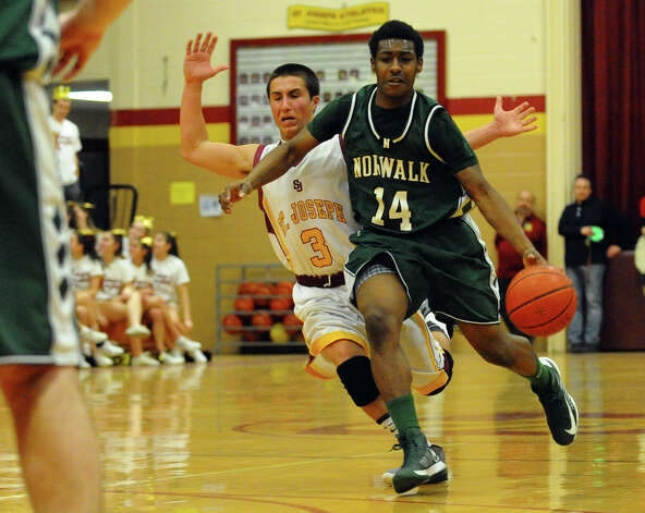 Boys basketball action between St. Joseph and Norwalk in Trumbull, Conn. on Tuesday February 2, 2013. Photo: Christian Abraham / Connecticut Post