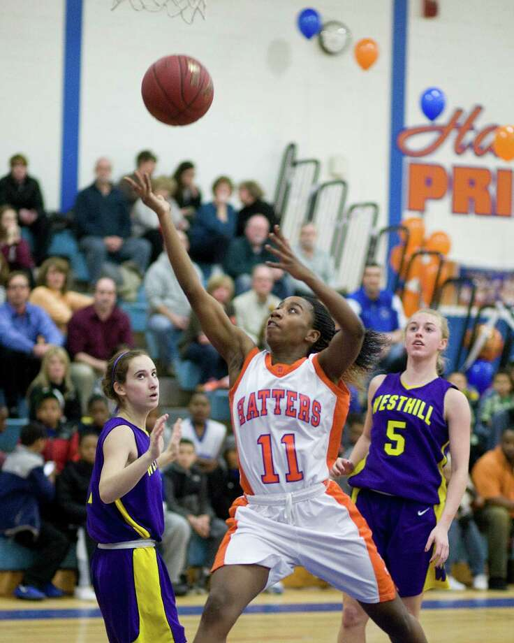 Danbury's Uniqua Tucker scores on a layup during Tuesday night's FCIAC game against Westhill at Danbury High School. Photo: Barry Horn