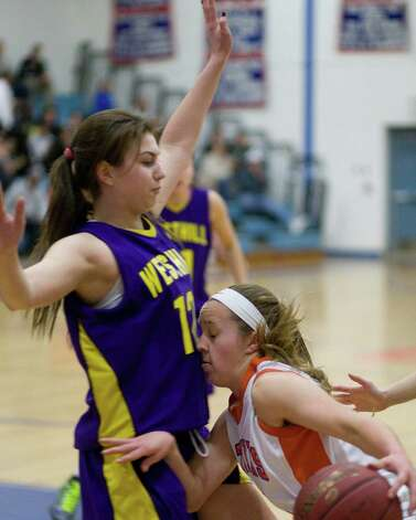 Danbury's Rebecca Gartner, right, hits a defensive wall while trying to drive against Westhill Tuesday night at Danbury High. Photo: Barry Horn