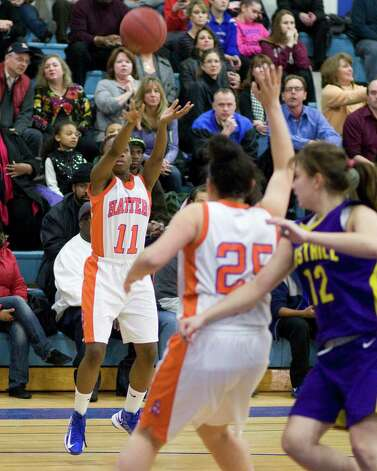 Danbury's Uniqua Tucker (11) sinks a jump shot against Westhill Tuesday night at Danbury High School. Photo: Barry Horn