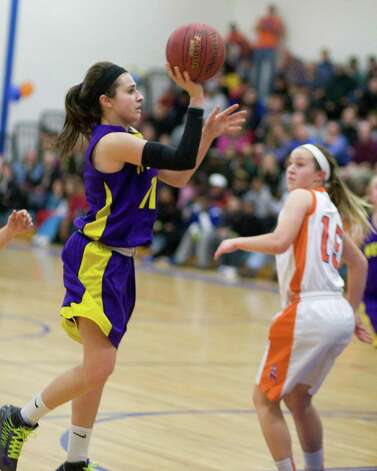 Westhill's Megan D'Alessandro shoots a jumper against Danbury Tuesday night at Danbury High School. Photo: Barry Horn