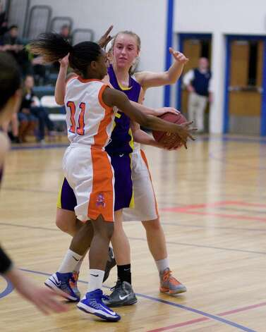 Danbury's Uniqua Tucker (11) gets a steal off a double team against Westhill Tuesday night at Danbury High School. Photo: Barry Horn