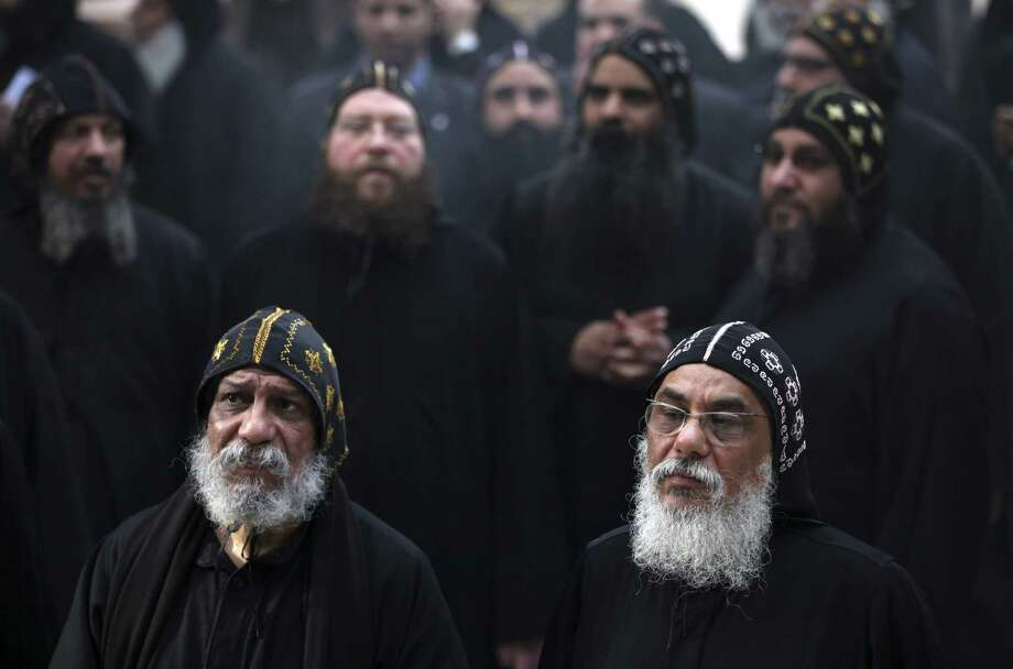 Clergymen wait for the arrival of Egypt's Coptic Christian Pope Tawadros II at the historic al-Muharraq Monastery, a centuries-old site some 180 miles south of Cairo, in Assiut. Photo: Khalil Hamra / Associated Press