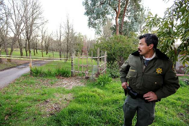 Sonoma County Sheriff's officer Hector Altamirano near the home of a triple homicide on Ross Station Road in Forestville, California. February 5, 2013. Photo: Erik Castro, Special To The Chronicle