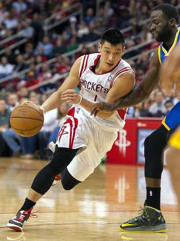 Houston Rockets' Jeremy Lin drives against Golden State Warriors' Draymond Green, right, during the fourth quarter of an NBA basketball game, Tuesday, Feb. 5, 2013, in Houston. The Rockets beat the Warriors 140-109. (AP Photo/Dave Einsel) Photo: Dave Einsel, Associated Press