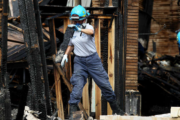 An ATF agent works at the site of the Childress church fire, the cause of which is still undetermined due to structural damage. Photo: John Davenport, San Antonio Express-News