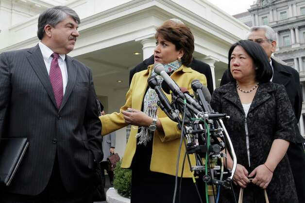From left, AFL-CIO President Richard Trumka; Janet Murguia, National Council of la Raza; and Mee Moua of the Asian American Justice Center, speak to reporters outside the White House in Washington, Tuesday, Feb. 5, 2013, following a meeting with President Obama about immigration reform and the economy.  (AP Photo/Charles Dharapak) Photo: Charles Dharapak