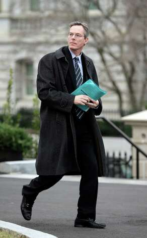 Paul Jacobs, Chairman and CEO of Qualcomm, is seen leaving the West Wing of the White House following a private meeting with President Obama and other business leaders, Tuesday, Feb. 5, 2013, to discuss immigration reform and the economy. (AP Photo/Pablo Martinez Monsivais) Photo: Pablo Martinez Monsivais