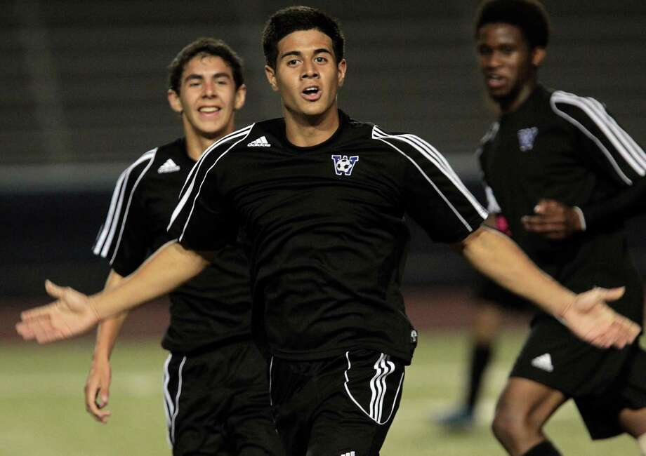 Westside's Jonathan Garay center, reacts after scoring a goal against Chavez during the first half of boys high school soccer game action at HISD's Barnett Stadium Tuesday, Feb. 5, 2013, in Houston. Photo: James Nielsen, Chronicle / © Houston Chronicle 2013