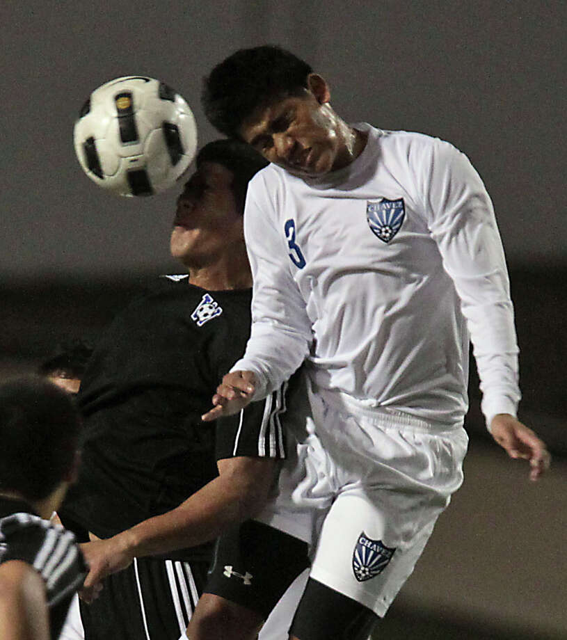 Westside's Jonathan Garay left, and Chavez' Kevin Perez header the ball during the first half of boys high school soccer game action at HISD's Barnett Stadium Tuesday, Feb. 5, 2013, in Houston. Photo: James Nielsen, Chronicle / © Houston Chronicle 2013