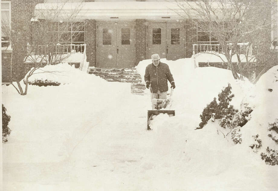 Feb. 7,1978:  Man clears Dolan School's front walk  in Stamford, Conn. during the blizzard of 1978. Photo: Staff File Photo, Stamford Advocate File Photo / Stamford Advocate file photo